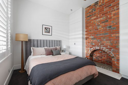 savvy-interiors-by-design-bedroom-fireplace-grey-bedhead